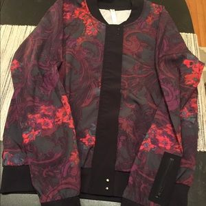 Women's Fabletics athleisure jacket.